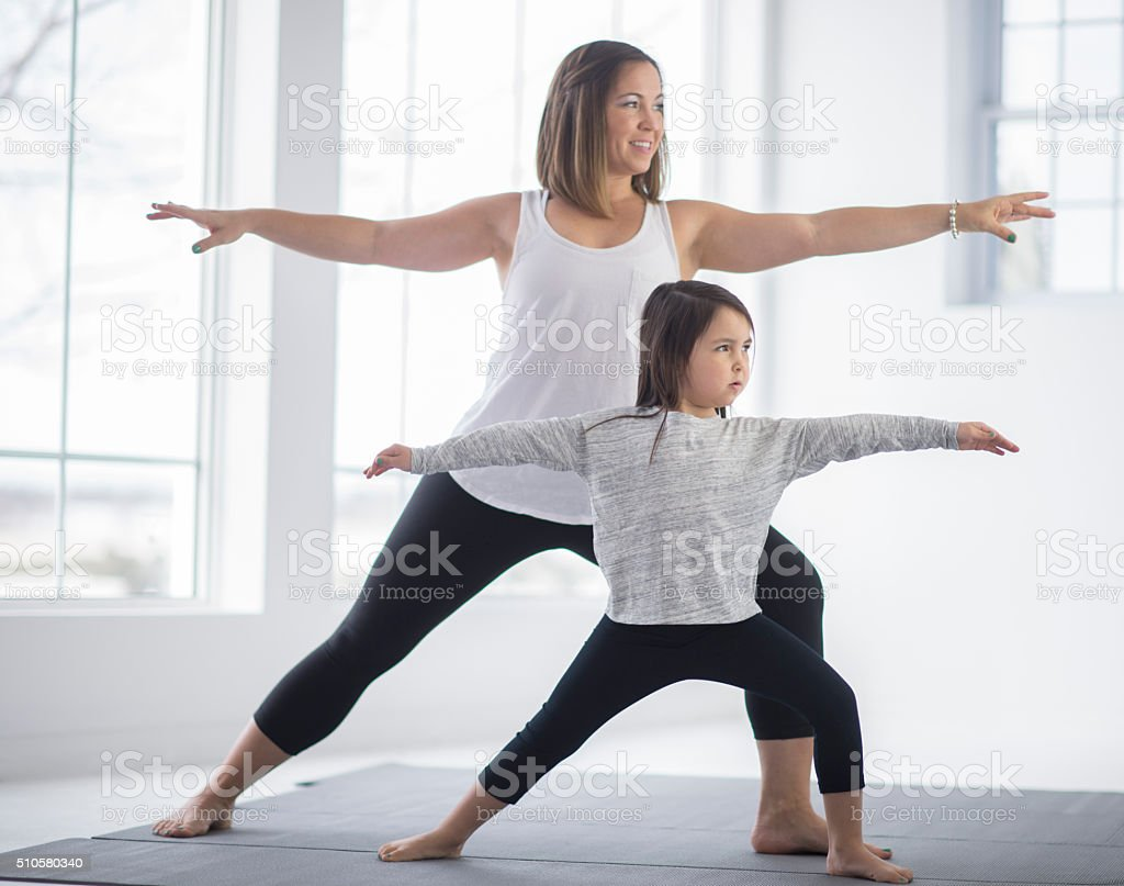 Holding a Warrior Pose stock photo