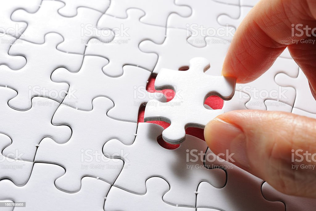 Holding a white blank final piece of the jigsaw royalty-free stock photo