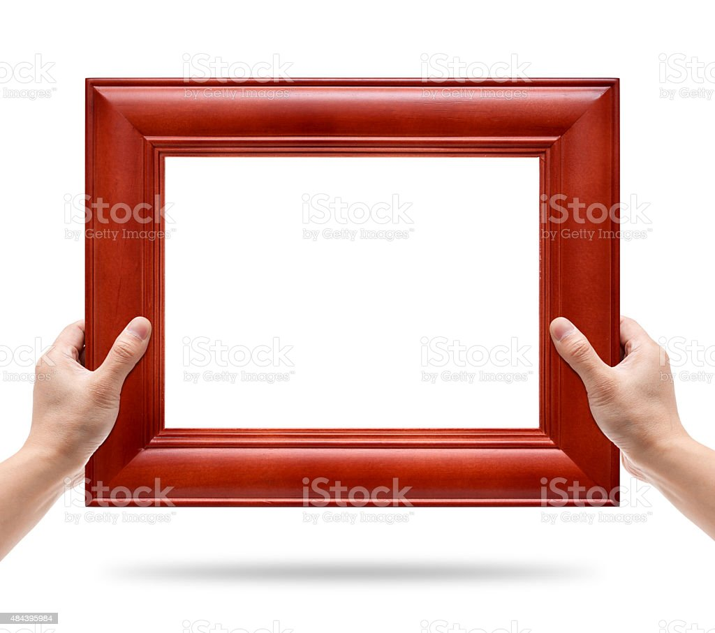 Holding a wood picture frame isolated on white background stock photo