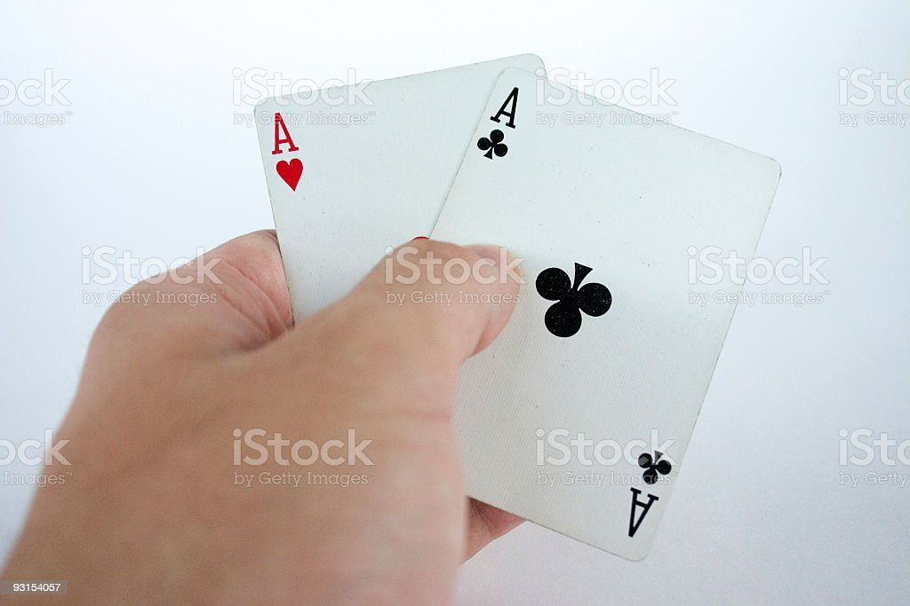 Holding Aces stock photo