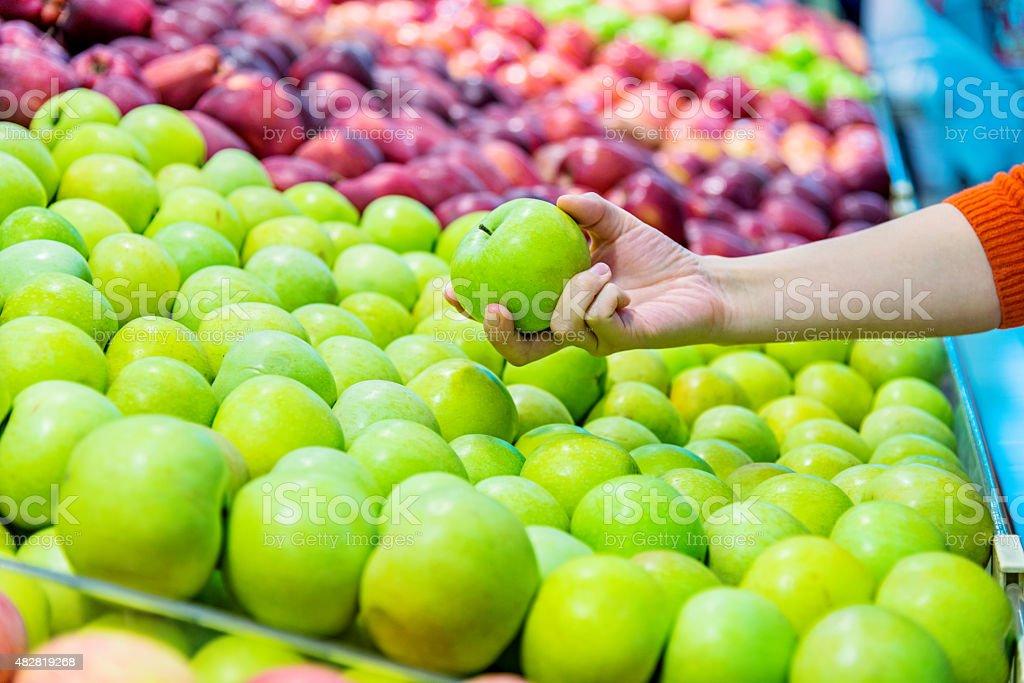 holding an apple stock photo
