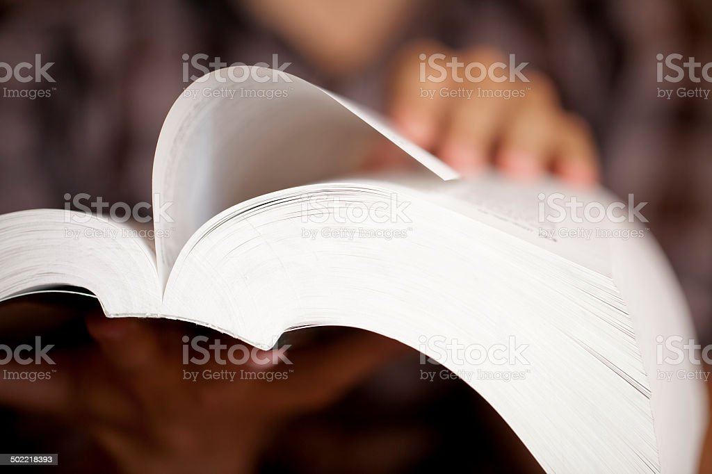 Holding an open book stock photo