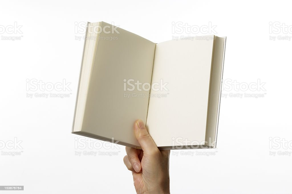 Holding an opened blank book against white background royalty-free stock photo