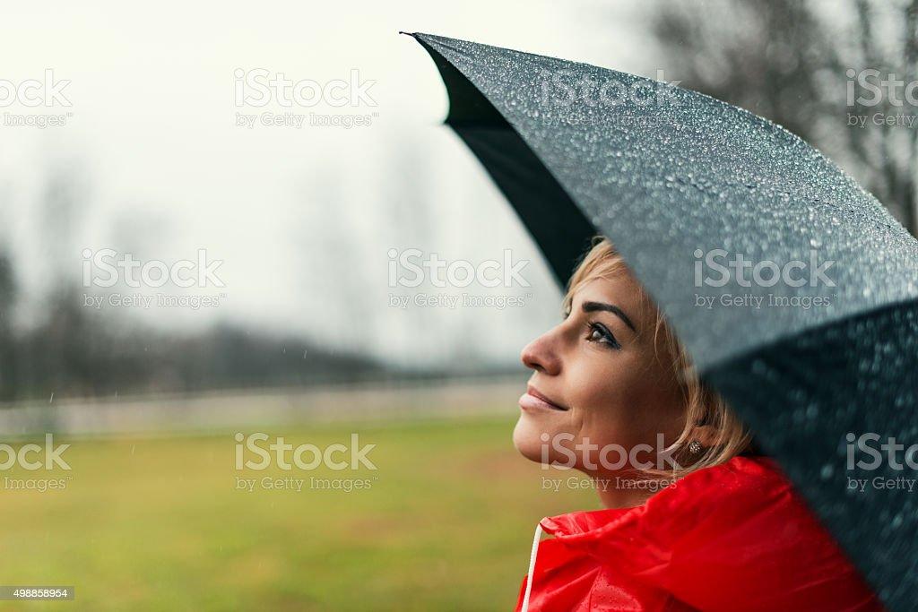 Holding an umbrella stock photo