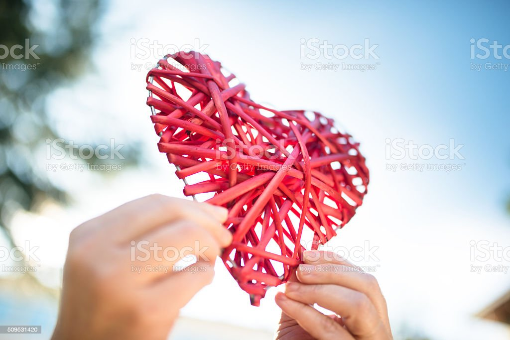 holding an wooden heart for st. valentine stock photo