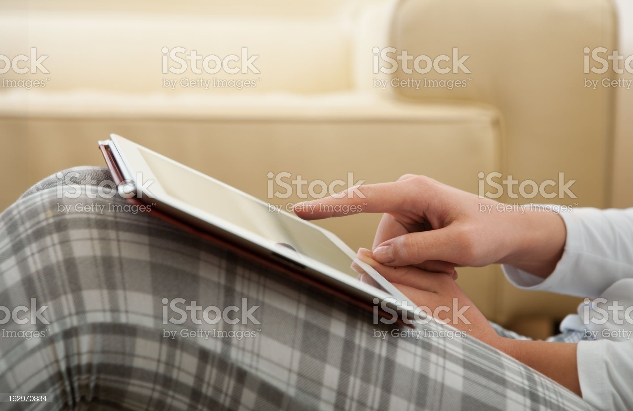 Holding And Point On Electronic Tablet PC royalty-free stock photo