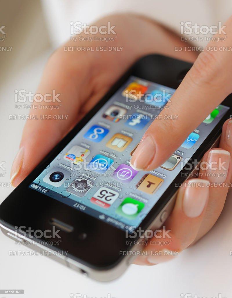 Holding Apple iPhone 4 royalty-free stock photo
