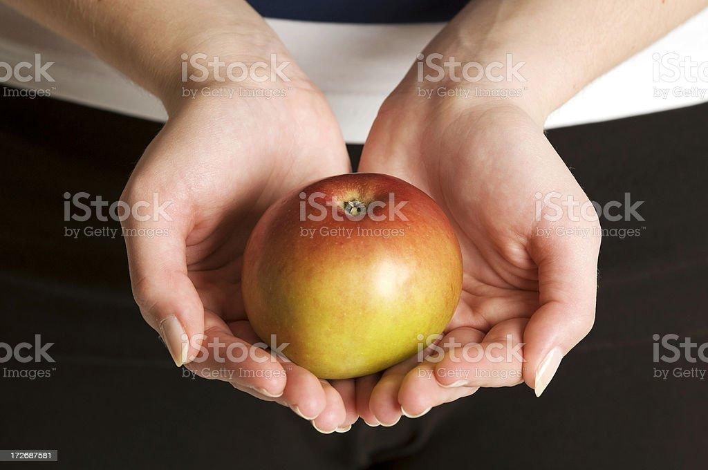 Holding apple royalty-free stock photo
