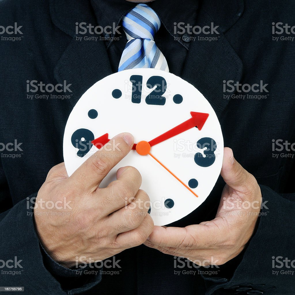 Holding back the hand of time stock photo