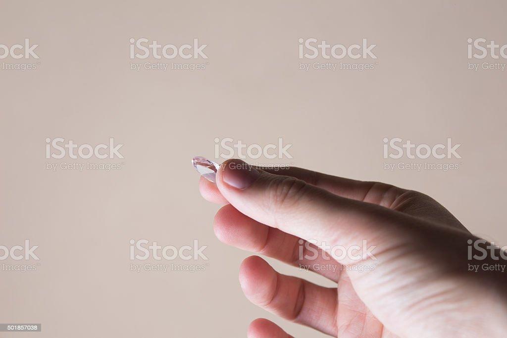 Holding big diamond stock photo