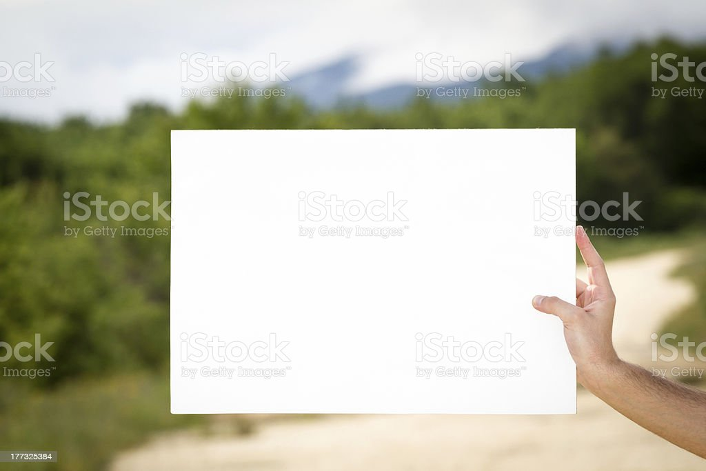 Holding blank billboard royalty-free stock photo