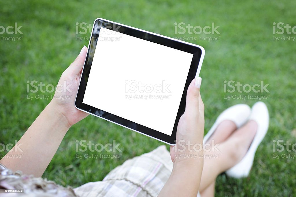 Holding blank tablet pc in park royalty-free stock photo