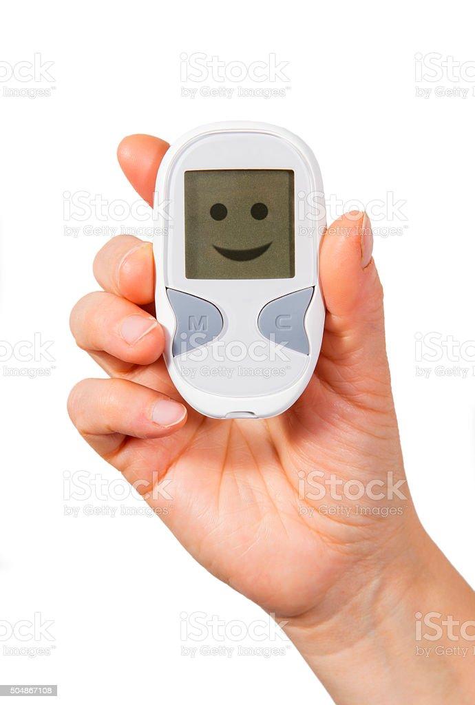 Holding blood sugar meter royalty-free stock photo