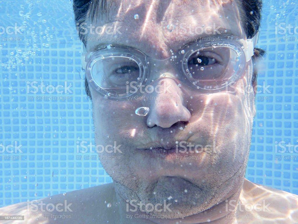 Holding breath underwater stock photo