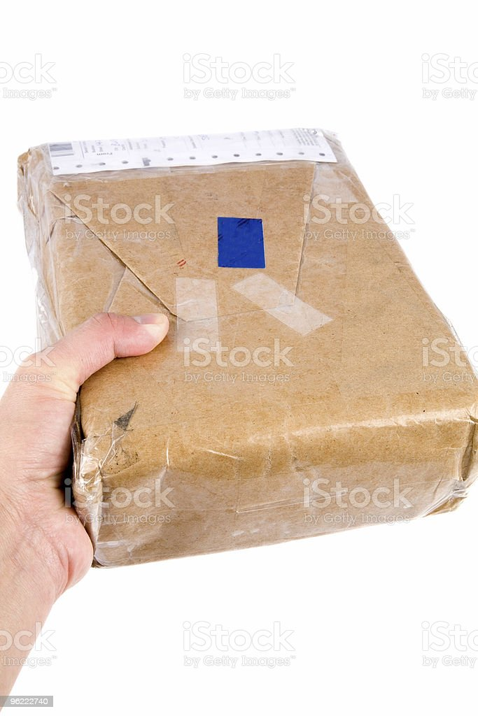 holding brown paper package stock photo
