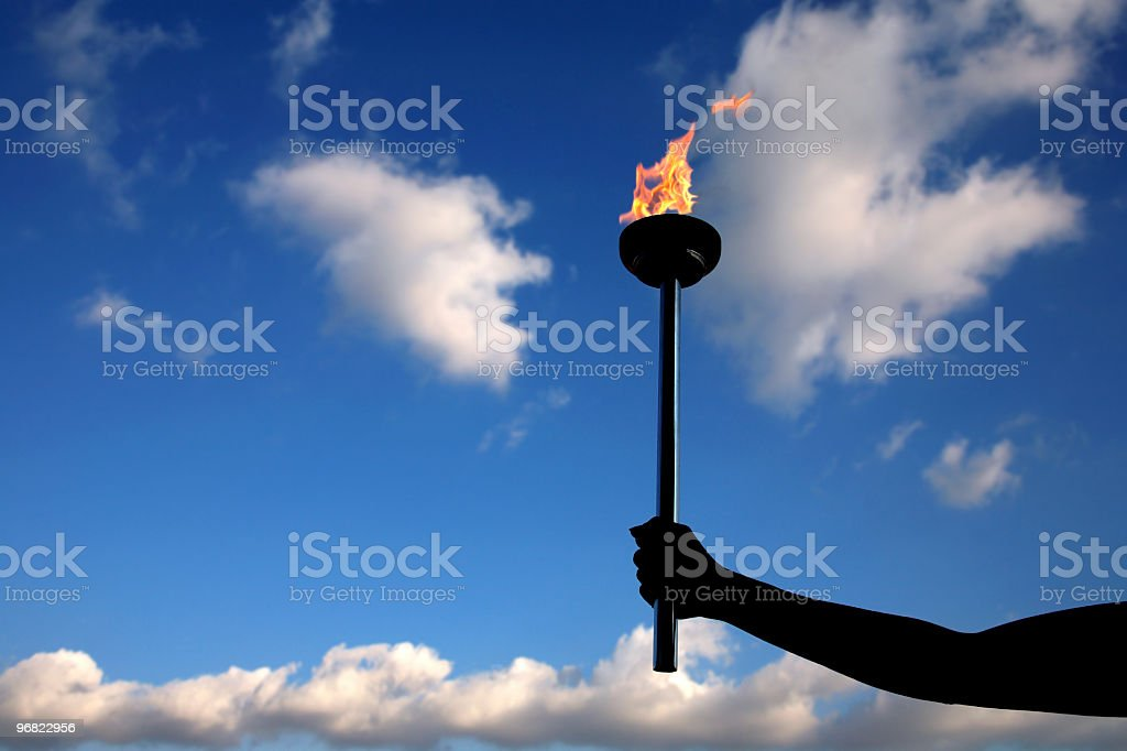 holding burning flaming torch stock photo