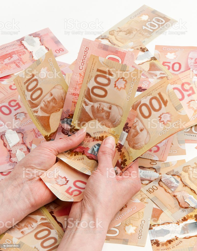 holding canadian curency stock photo