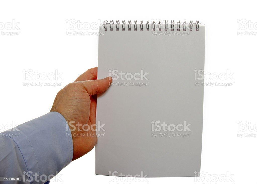 Holding Checklist Notebook stock photo