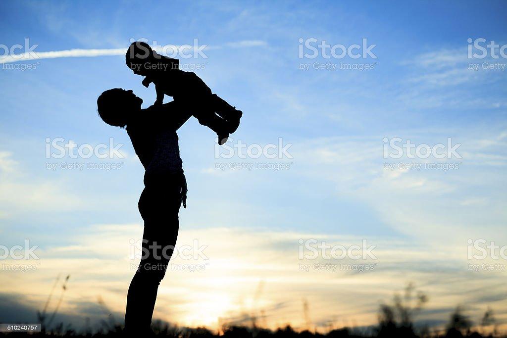 Holding Child Sky Back Lit stock photo