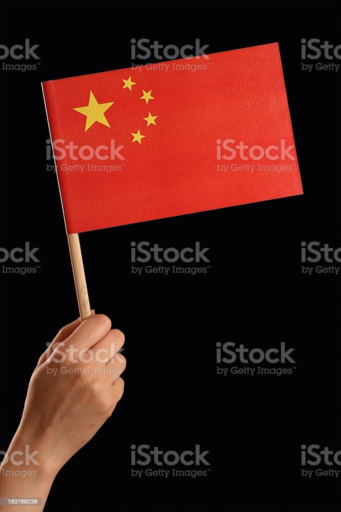 Holding Chinese flag royalty-free stock photo