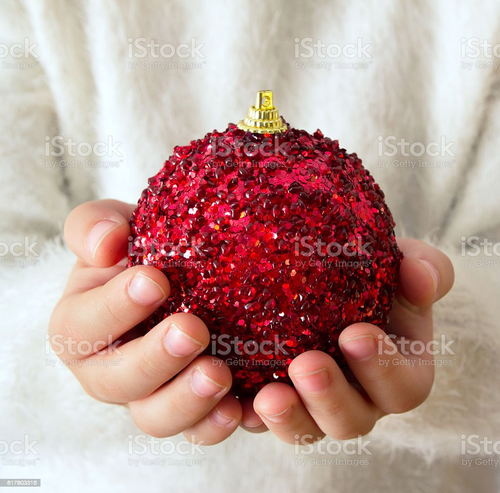 holding christmas ball stock photo
