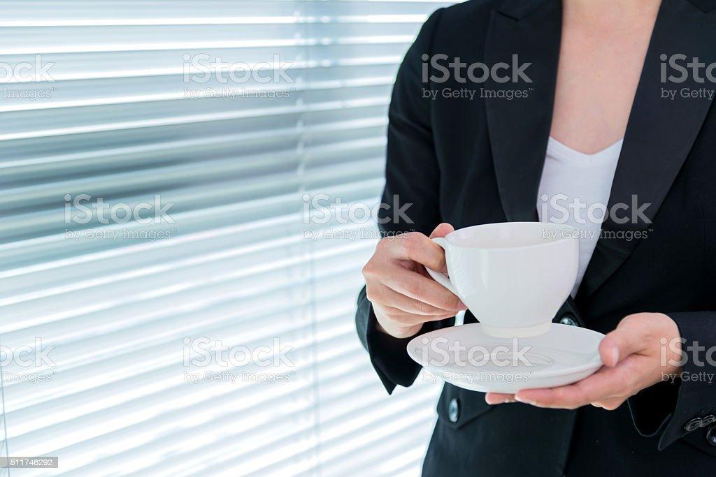 holding coffee stock photo