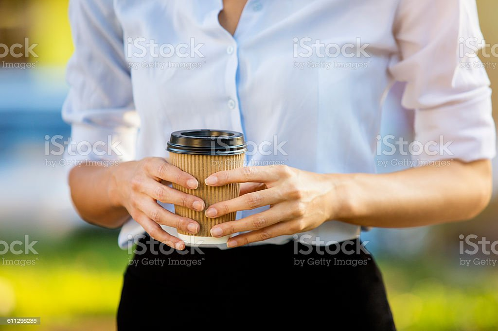 Holding coffee to go close up stock photo