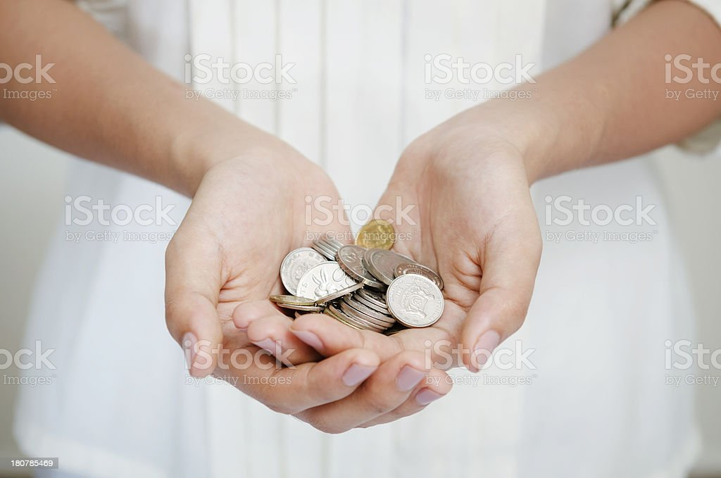 Holding coins stock photo