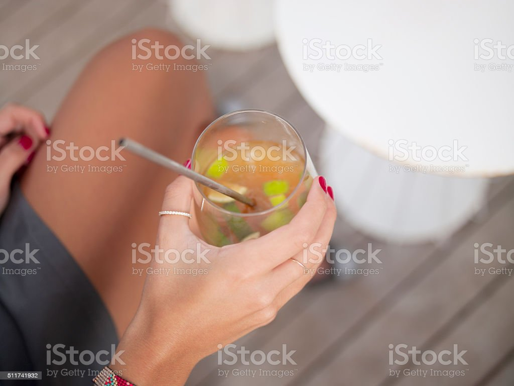 holding cold drink stock photo