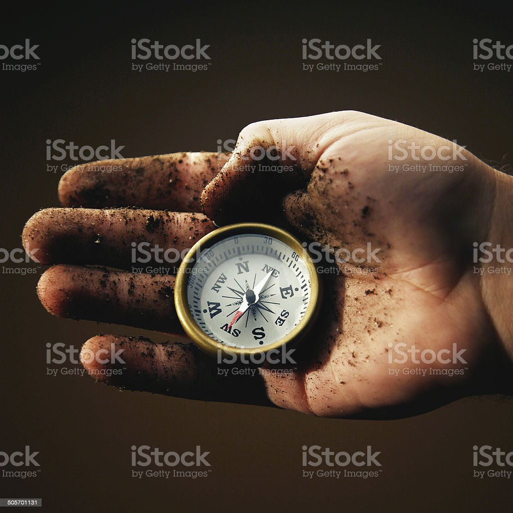 Holding compass royalty-free stock photo