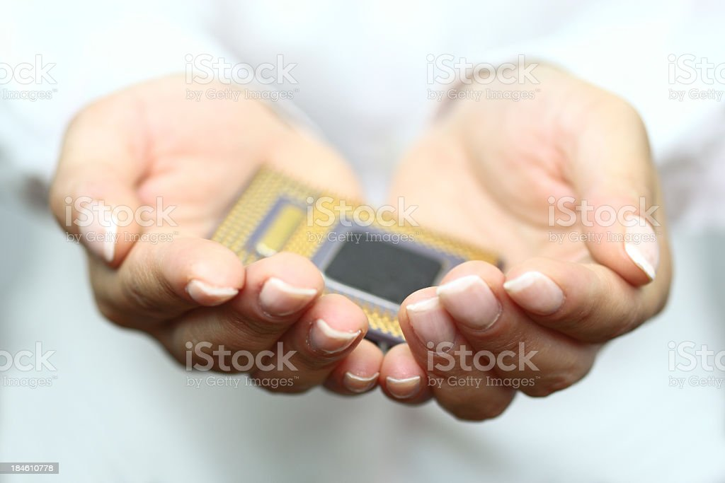 Holding computer chip stock photo