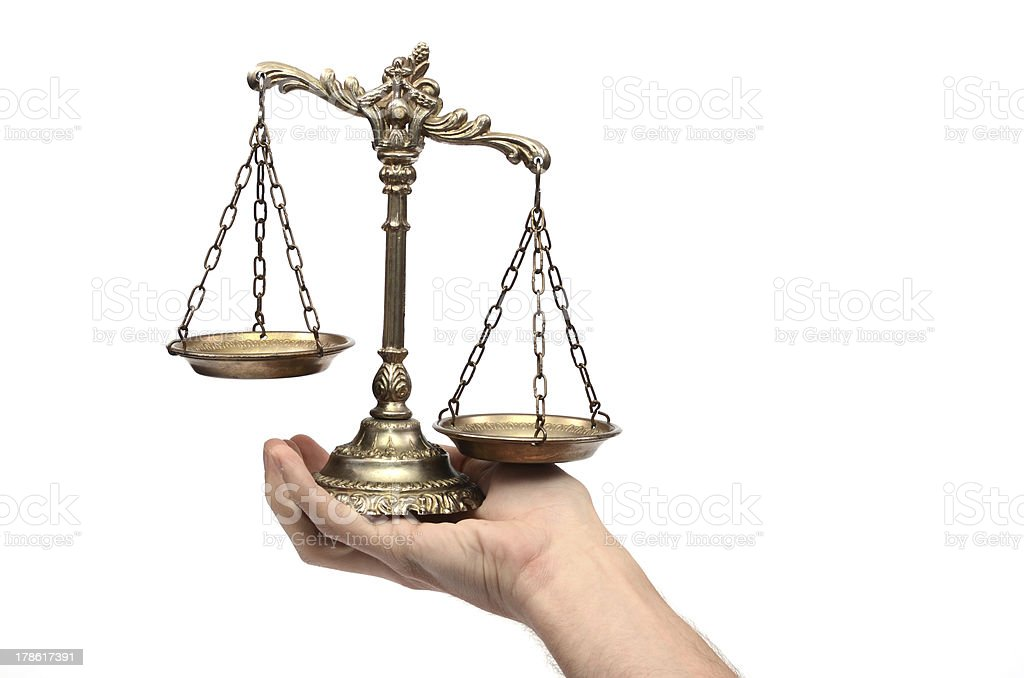 Holding Decorative Scales of Justice royalty-free stock photo