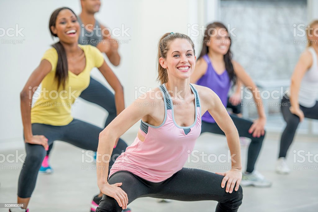 Holding Deep Squats at the Gym stock photo