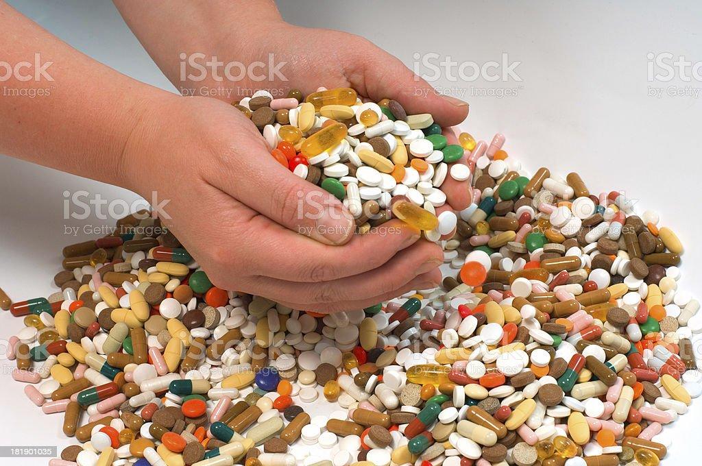 holding drugs stock photo