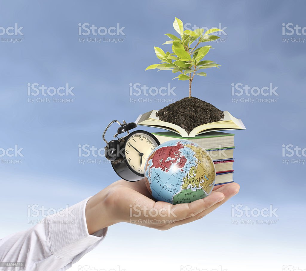 Holding earth and Education stock photo