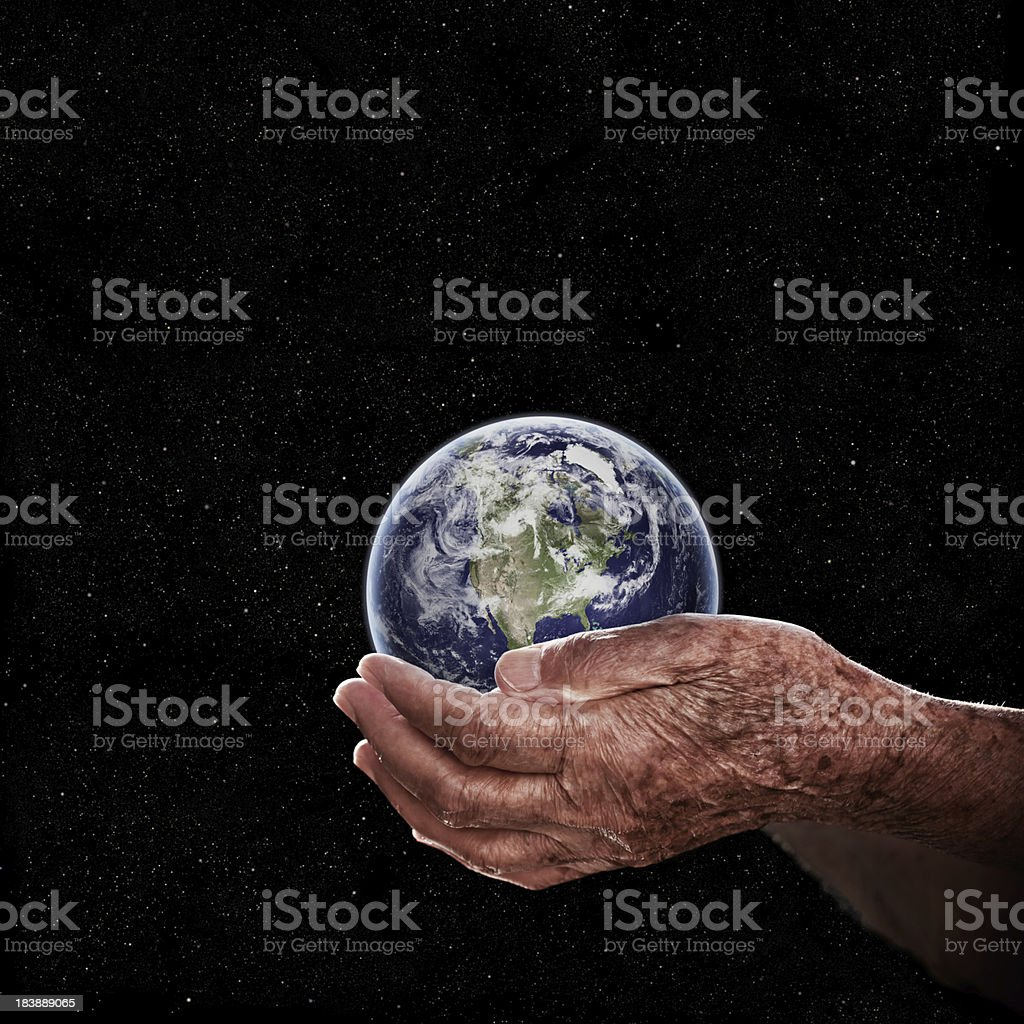 Holding Earth royalty-free stock photo