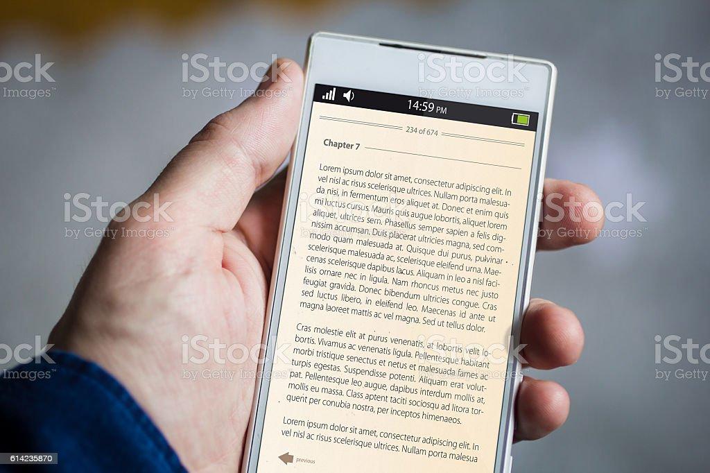 holding e-book smartphone stock photo