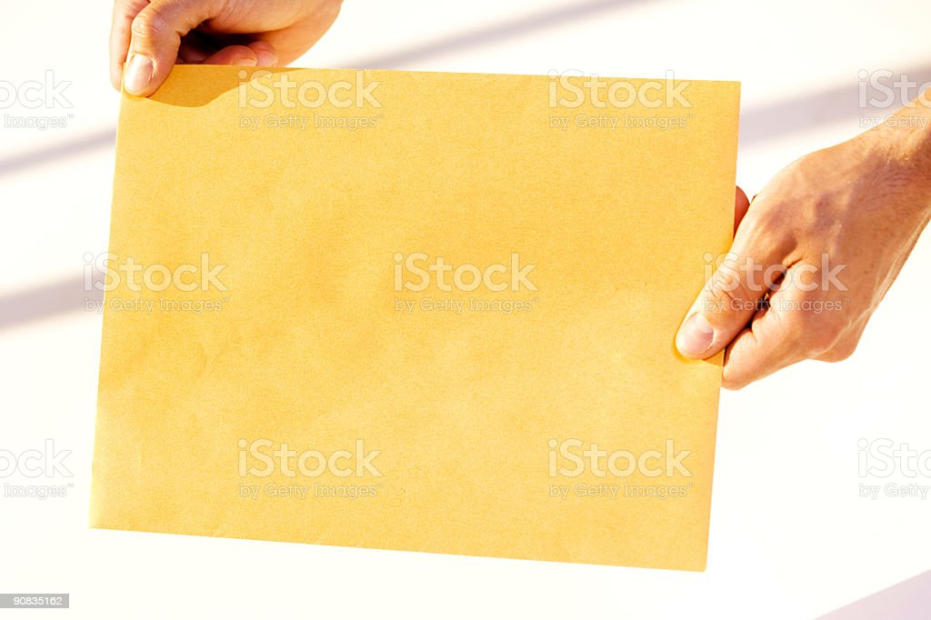 Holding Envelope stock photo