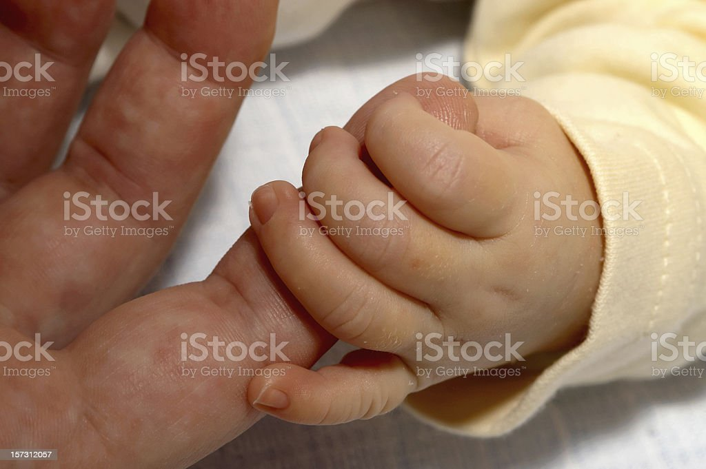 Holding finger. royalty-free stock photo
