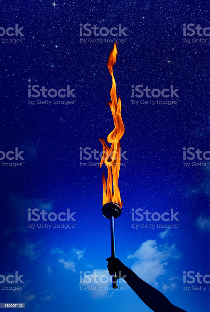 holding flaming torch stock photo