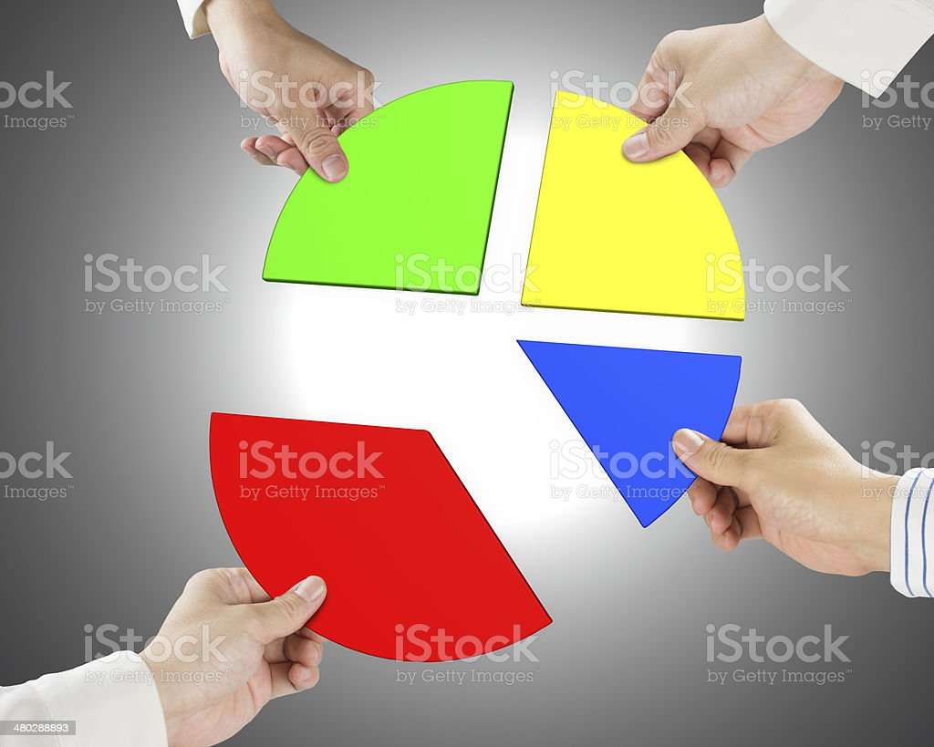 Holding four pie chart pieces stock photo