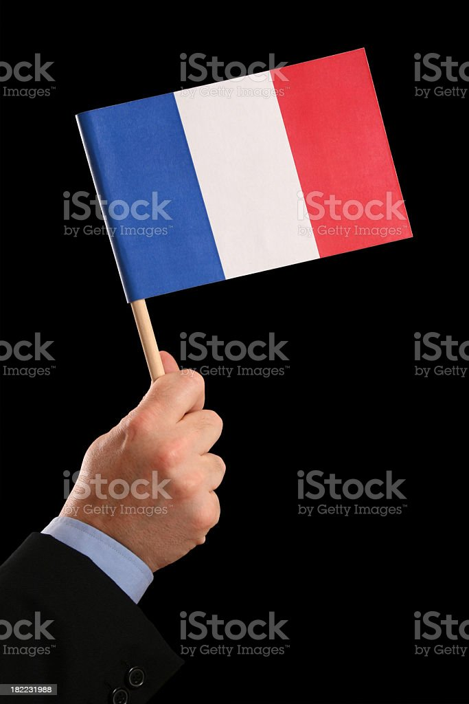 Holding french flag stock photo