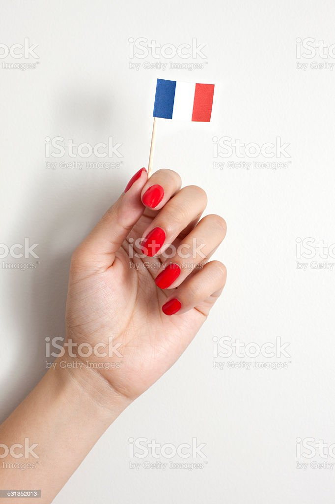 Holding french flag stock photo