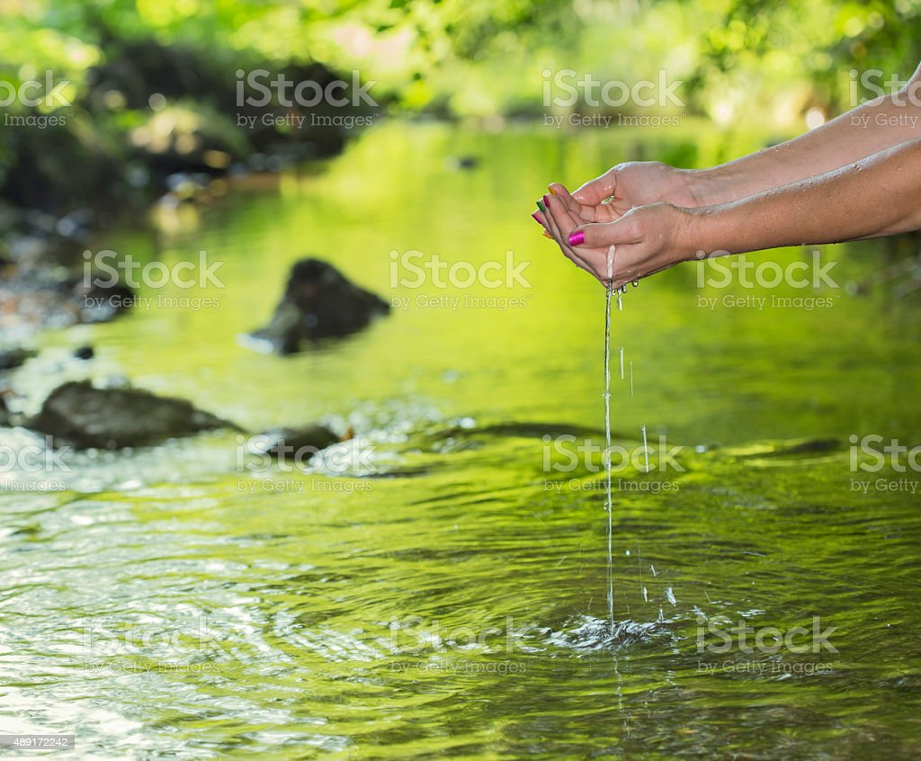 Holding fresh water stock photo