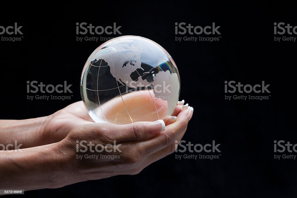 Holding globe stock photo