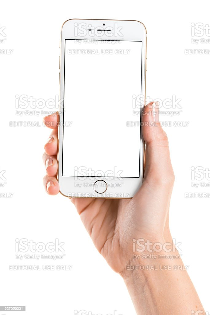 Holding gold iPhone 6 with white screen stock photo