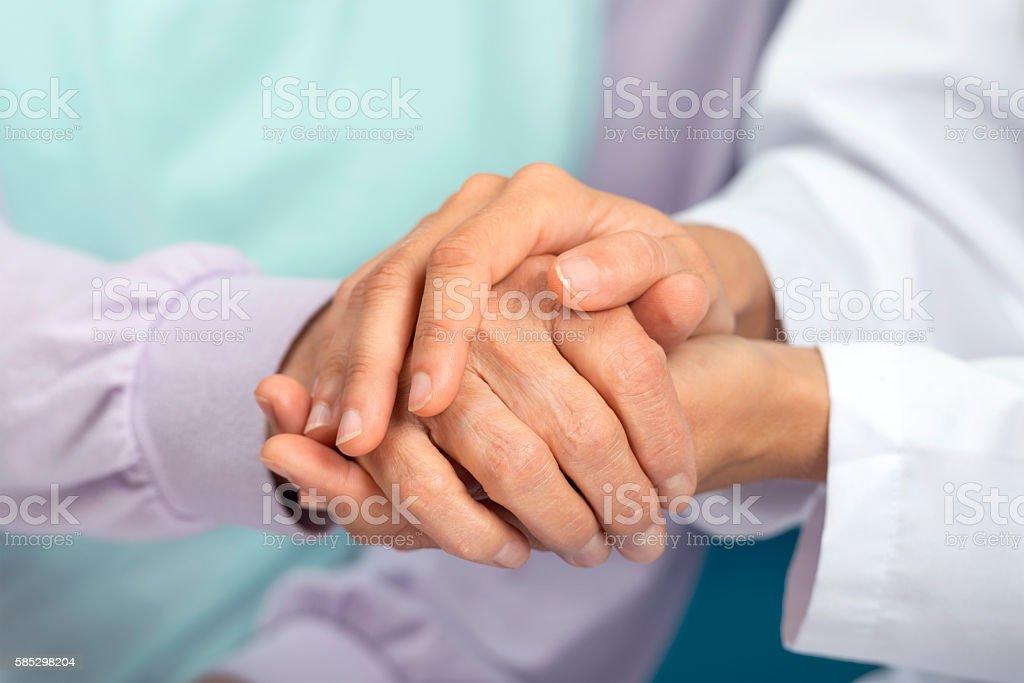 Holding hand stock photo