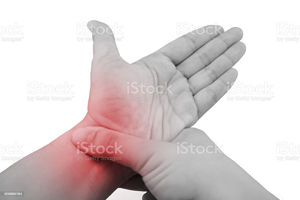 holding hand to spot of wrist pain. stock photo