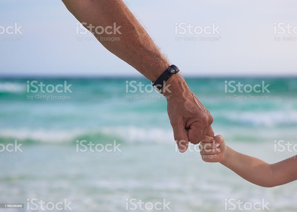 Holding Hands at the Beach with Grandpa royalty-free stock photo