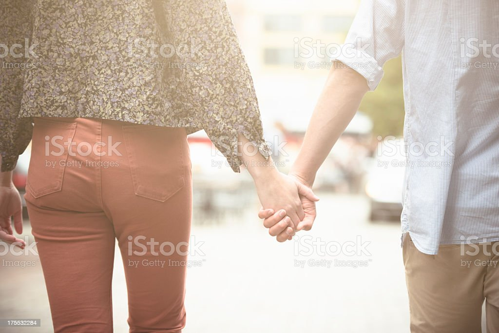 Holding hands, caucasian couple in love stock photo